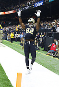 Nov 4, 2018; New Orleans, LA, USA: New Orleans Saints tight end Benjamin Watson (82) celebrates a touchdown against the Los Angeles Rams at the Mercedes-Benz Superdome by putting the ball under his shirt during a TD celebration to commemorate that he and his wife are expecting twins. The Saints beat the Rams 45-35. (Steve Jacobson/Image of Sport)