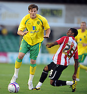 Lincoln - Wednesday, July 28th, 2010: Lincoln's' Cian Hughton challenges Norwichs's Wes Hoolahan during the Pre Season friendly match at Sincil Bank. (Pic by Andrew Stunell/Focus Images)