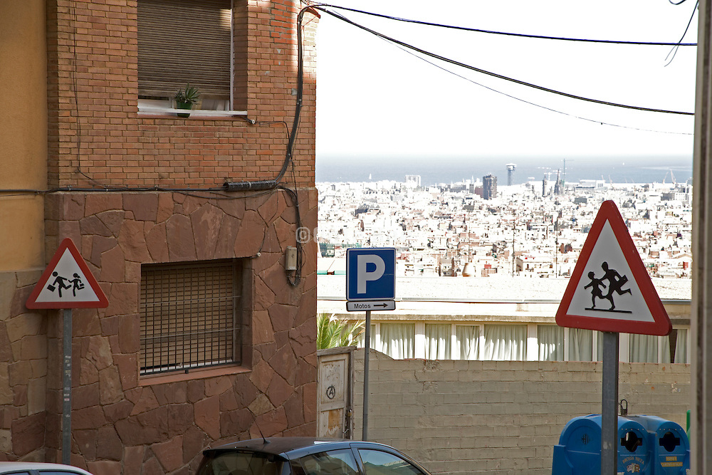 Barcelona street with different children at play warning signs