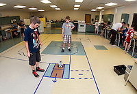 """Jacob and Ethan program their Lego robotic droid to maneuver through the first phase of the maze during """"Let Go Your Mind"""" summer camp through Gilford Parks and Recreation at the Gilford Middle School on Wednesday.   (Karen Bobotas/for the Laconia Daily Sun)"""