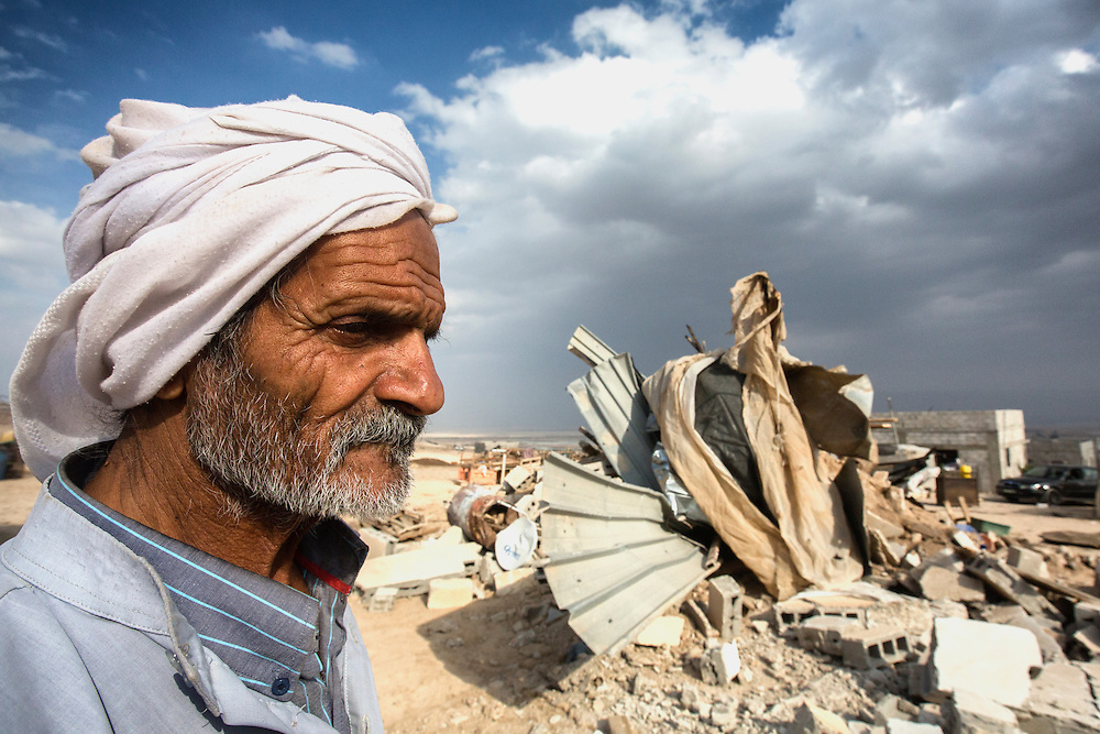 A village elder in the ruins of his home in Al Auja that Israeli forces demolished the previous night. Dec. 4, 2013. West Bank, Palestinian Territories. (Photo by Gabriel Romero/Alexia Foundation ©2014)