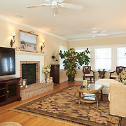 LONG BEACH, NJ - SEPTEMBER 16, 2016: The first floor living room features a gas fireplace and an integrated ceiling-mounted speaker system and a pair of ceiling fans. A block of windows on either end let in light from the front and rear of the property. 6 E. 34 Street, Long Beach, NJ. Credit: Albert Yee for The New York Times