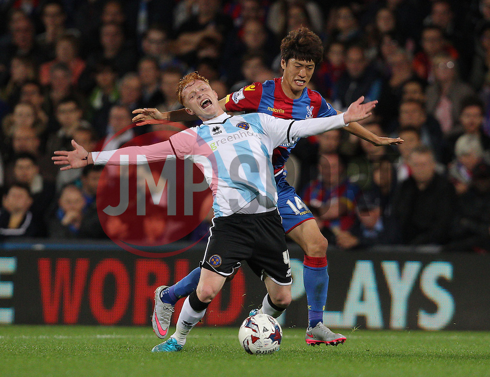 Lee Chung-Yong of Crystal Palace and Ryan Woods of Shrewsbury Town challenge for the ball - Mandatory byline: Paul Terry/JMP - 07966386802 - 25/08/2015 - FOOTBALL - Selhurst Park -London,England - Crystal Palace v Shrewsbury town - Capital One Cup - Second Round
