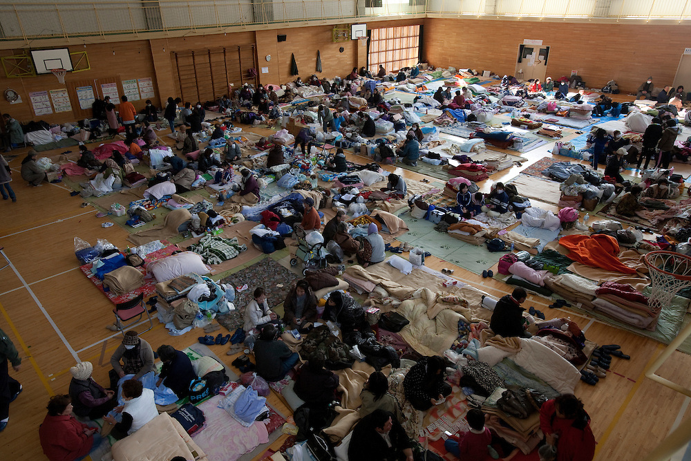 Residents of the town of Kirikiri stay in a shelter after the earthquake and tsunami hit the city on 11 March 2011.