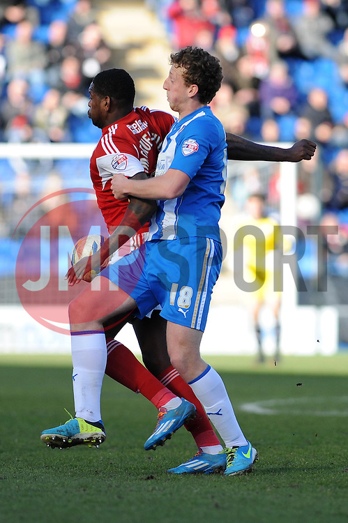 Bristol City's Jay Emmanuel-Thomas keeps hold off the ball from Colchester United's Tom Eastman - Photo mandatory by-line: Dougie Allward/JMP - Mobile: 07966 386802 22/03/2014 - SPORT - FOOTBALL - Colchester - Colchester Community Stadium - Colchester United v Bristol City - Sky Bet League One