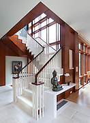 Private home on Connecticut shoreline photographed for builder. The rich warm wood panels contrast beautifully with the white stone and masonry throughout the house.