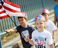 Molly Lapolla, a kindergarten student holds an American flag a she and other students participate in the annual Walk to Remember fundraiser for the Garden of Reflection during the Patriot Day celebration Friday September 9, 2016 at Lower Makefield Elementary School in Lower Makefield, Pennsylvania. (Photo by William Thomas Cain)