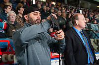 KELOWNA, CANADA - FEBRUARY 18: Prince George Cougars' equipment manager Ramandeep S. Dhanjal (Chico) stands on the bench taping a stick against the Kelowna Rockets on February 18, 2017 at Prospera Place in Kelowna, British Columbia, Canada.  (Photo by Marissa Baecker/Shoot the Breeze)  *** Local Caption ***