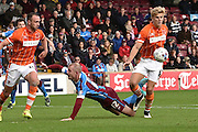 Brad Potts  takes ball away from Neil Bishop during the Sky Bet League 1 match between Scunthorpe United and Blackpool at Glanford Park, Scunthorpe, England on 5 September 2015. Photo by Ian Lyall.