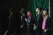 Kianna Barranco (Center) participates in undergraduate commencement. Photo by Ben Siegel