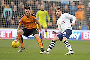 Preston North End striker Joe Garner plays the ball away from Wolverhampton Wanderers defender Danny Batth during the Sky Bet Championship match between Wolverhampton Wanderers and Preston North End at Molineux, Wolverhampton, England on 13 February 2016. Photo by Alan Franklin.