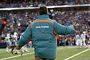Dolphins head coach Dave Wannstedt motions toward the field during a 20 to 3  win by the Miami Dolphins over the Buffalo Bills in an NFL Week 16 game in Buffalo on December 21, 2003. ©Paul Anthony Spinelli