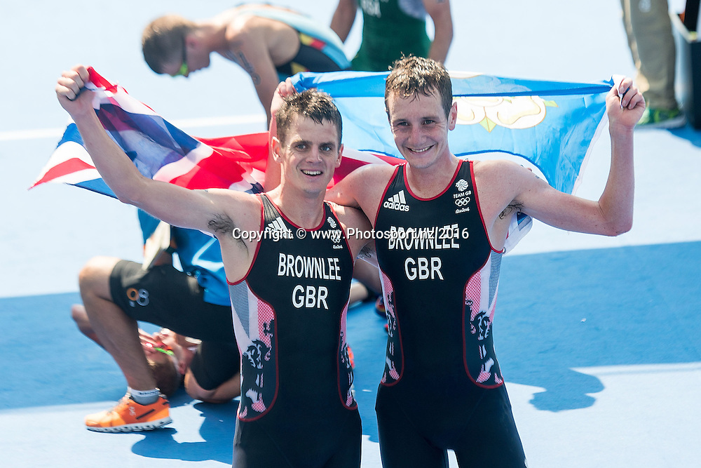 Great Britain's Alistair and Jonathan Brownlee celebrate winning the Men's triathlon during the Men's triathlon at Forte Copacabana at the 2016 Rio Olympics on Thursday the 18th of August 2016. © Copyright Photo by Marty Melville / www.Photosport.nz