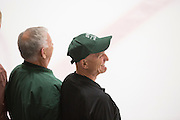 Jake Peterson stands on the ice with other 1960s hockey alumni after the first period of the OU vs. Kent State hockey game at Bird Arena on September 30, 2016.