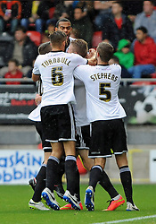 Swindon Town's Michael Smith celebrates scoring his sides first goal with team mates - photo mandatory by-line David Purday JMP- Tel: Mobile 07966 386802 - 04/10/14 - Leyton Orient  v Swindon Town - SPORT - FOOTBALL - Sky Bet Leauge 1  - London -  Matchroom Stadium