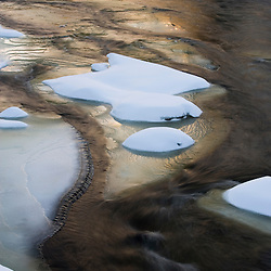 Snow and ice patterns in the Ashuelot River in Winchester, New Hampshire.