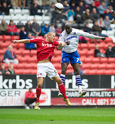 LONDON, ENGLAND - Saturday, October 8, 2011: Tranmere Rovers' Enoch Showunmi and Charlton Athletic's Michael Morrison in action during the Football League One match at The Valley. (Pic by Gareth Davies/Propaganda)