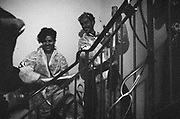 Man and woman standing on steps laughing, location and date unknown