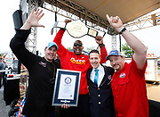 Kansas City Corporate Event Photographer-<br /> From left; Weber Griillmaster Kevin Kolman, Kansas City Chiefs defensive end Chris Jones, Guinness World Records adjudicator Philip Robertson, and World Champion pitmaster Chris Lilly celebrate Smithfield setting the Guinness World Records title for Largest grilling lesson on Thursday, April 27, 2017, in Kansas City, Mo. Colin E. Braley for Smithfield