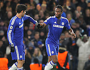 Chelsea's Mikel John Obi is congratulated by Chelsea's Diego Costa during the UEFA Champions League match between Chelsea and Sporting Lisbon at Stamford Bridge, London, England on 10 December 2014.