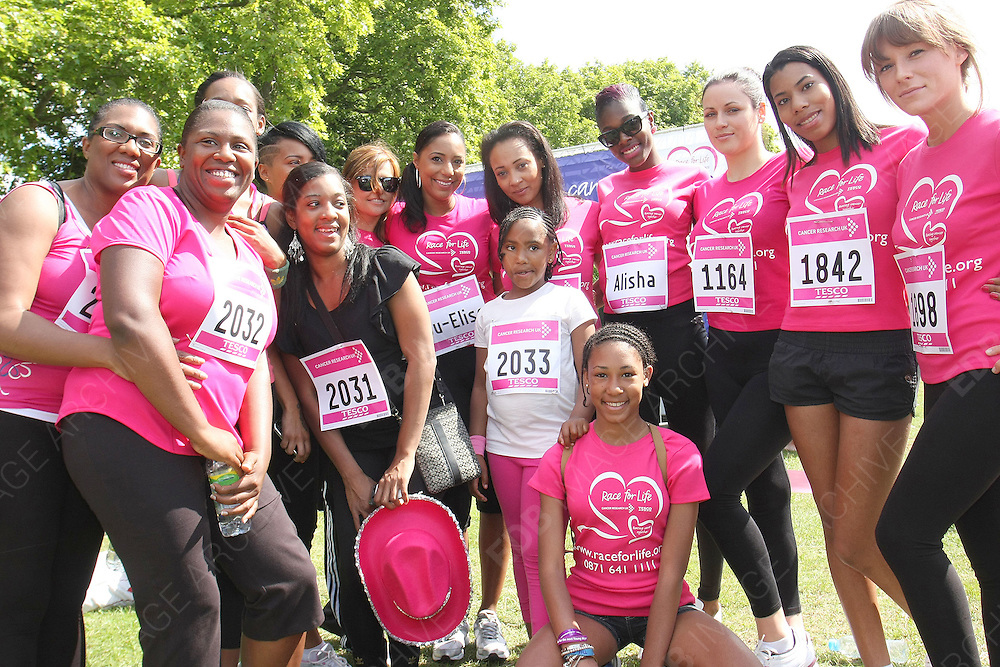 30.JULY.2011. LONDON<br /> <br /> SO SOLID CREW SINGER LISA MAFFIA AND MIS-TEEQ SINGER SUE ELISE NASH RUN THE RACE FOR LIFE IN CLAPHAM COMMON IN LONDON, RAISING MONEY FOR CANCER RESEARCH <br /> <br /> BYLINE: EDBIMAGEARCHIVE.COM<br /> <br /> *THIS IMAGE IS STRICTLY FOR UK NEWSPAPERS AND MAGAZINES ONLY*<br /> *FOR WORLD WIDE SALES AND WEB USE PLEASE CONTACT EDBIMAGEARCHIVE - 0208 954 5968*