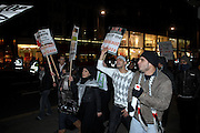 London 04/01/09: Protests outside the Israeli Embassy in London UK: Police dispersed the protesters along Kensington High Strret amongst sale shoppers
