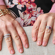 Susan Sotiropoulos pose for a photo while wearing a Sweater, top, jeans, bracelet, wrap, handbag, shoes:  White House Black Market, Pink tourmaline and diamond ring, Roberto Coin diamond ring, Gold hoop earrings:  Bove Jewelers, Necklace:  handmade in Greece Saturday, May 19, 2018, at White House Black Market Street in Greenville.