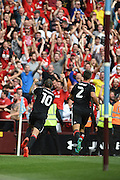 Nottingham Forest midfielder Henri Lansbury (10) celebrities his second half equaliser to put the Reds 2-2 during the EFL Sky Bet Championship match between Aston Villa and Nottingham Forest at Villa Park, Birmingham, England on 11 September 2016. Photo by Jon Hobley.