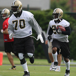 2008 May 21: New Orleans Saints offensive tackle Jammal Brown #70 leads with a block for running back Reggie Bush #25 during team organized activities at the Saints training facility in Metairie, LA. .