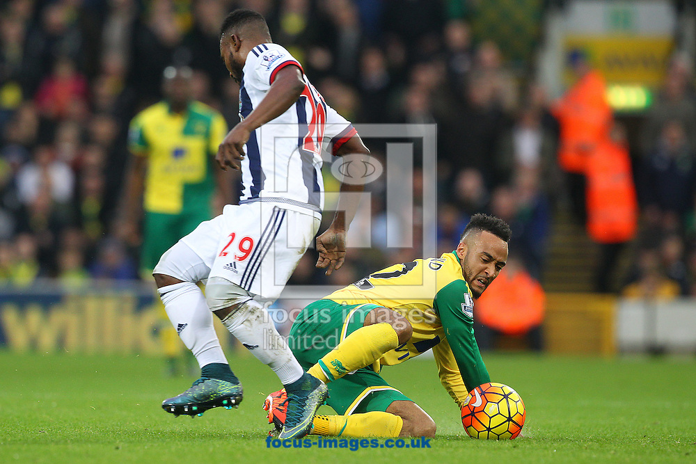 Nathan Redmond of Norwich and Stephane Sessegnon of West Bromwich Albion in action during the Barclays Premier League match at Carrow Road, Norwich<br /> Picture by Paul Chesterton/Focus Images Ltd +44 7904 640267<br /> 24/10/2015