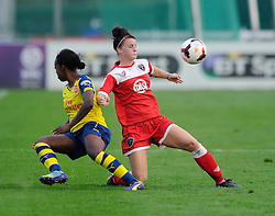 Arsenal Ladies' Danielle Carter is challenged by Bristol Academy Women's Jasmine Matthews  - Photo mandatory by-line: Dougie Allward/JMP - Mobile: 07966 386802 - 20/09/2014 - SPORT - FOOTBALL - Bristol - SGS Wise Campus - BAWFC v Arsenal Ladies - FA Womens Super League