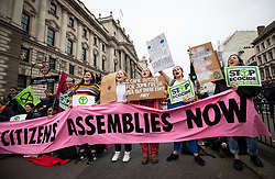 © Licensed to London News Pictures. 07/10/2019. London, UK. Climate change activists hold a sit down protest blocking all traffic on Whitehall, London, as part of a wider two week long demonstration to cause disruption in the capital. The activists are calling for the government to acknowledge and act on climate change. Photo credit : Tom Nicholson/LNP
