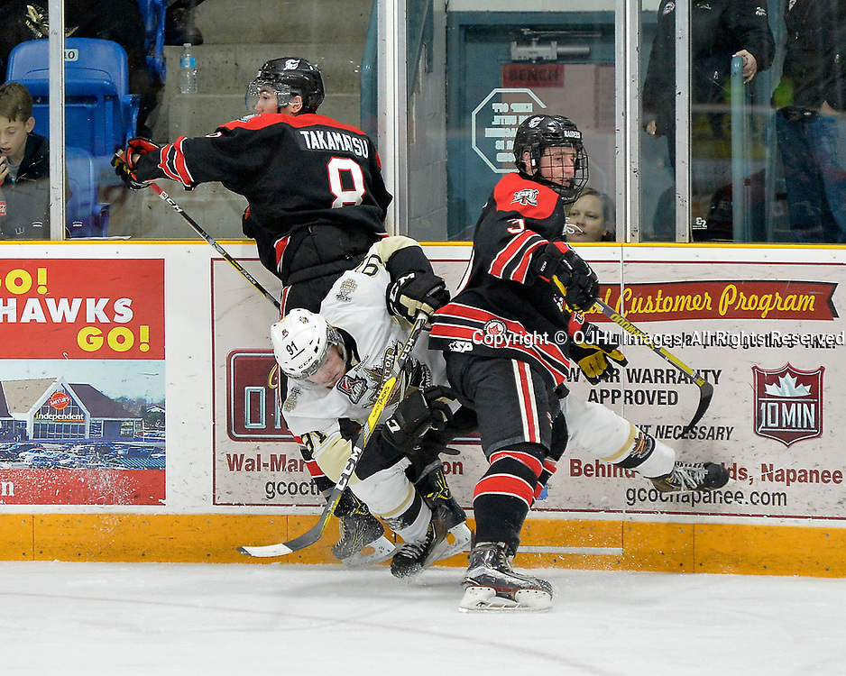 TRENTON, ON  - APR 15,  2017: Ontario Junior Hockey League, Championship Series.  Georgetown Raiders vs the Trenton Golden Hawks in Game 2 of the Buckland Cup Final.  Mac Lewis #91 of the Trenton Golden Hawks takes the hit from Ryan Takamatsu #8 and Mitch Brewer #3 of the Georgetown Raiders during the first period.<br /> (Photo by Shawn Muir / OJHL Images)