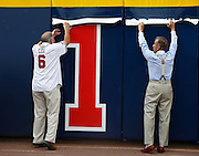 ATLANTA, GA - OCTOBER 2:  Former Atlanta Braves manager Bobby Cox (left) and current team president Jon Schuerholz take down the last Home Games Remaining number during the game between the Detroit Tigers and the Atlanta Braves at Turner Field on Sunday, October 2, 2016 in Atlanta, Georgia. (Photo by Mike Zarrilli/MLB Photos via Getty Images) *** Local Caption ***