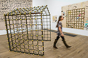Potato House- Alibis a Sigmar Polke retrospective at the Tate Modern – he was viewed as one of the most experimental artists of recent times and the exhibition covers his full career, bringing together works from around the world in a huge variety of materials. Highlights include: Girlfriends – An iconic early Pop painting from 1965 of a bikini-clad girl; Potato House – Standing over 6 feet tall, this sculpture of a house is made from wooden lattices covered in real potatoes; Mao – A huge felt banner covered in scraps of cloth and painted with an image of Chairman Mao; Watchtowers – A series of neon-coloured paintings incorporating silver, resin, fabric and bubble-wrap; and other paintings made from such diverse materials as meteorite dust, soot, lead, coal, elastic bands and medical tape. The exhibition runs from 9 October 2014 – 8 February 2015.  Tate Modern, Bankside, London, UK 07 Oct 2014.