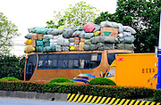 SUZHOU, CHINA - OCTOBER 22:  (CHINA OUT - FINLAND OUT) <br /> <br /> Overloaded Bus<br /> A bus is seen overloaded with baggages on its roof on October 22, 2013 in Suzhou, Jiangsu Province of China. <br /> ©Exclusivepix