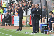 Joe Dunne and Russell Milton  during the EFL Sky Bet League 2 match between Cambridge United and Cheltenham Town at the Cambs Glass Stadium, Cambridge, England on 25 August 2018.