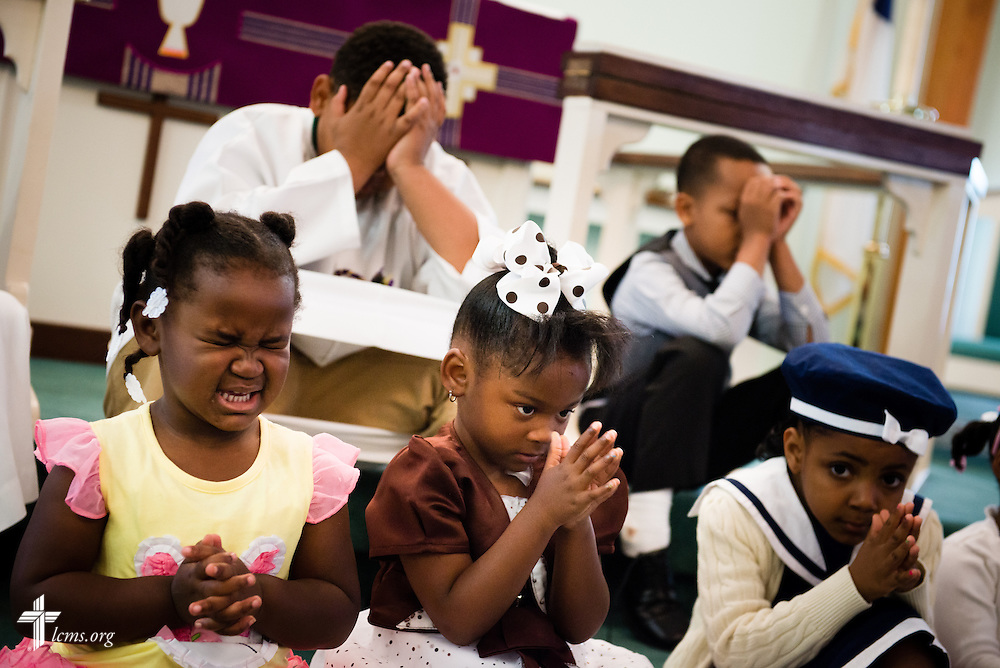 Children pray during worship at Trinity Lutheran Church Sunday, April 6, 2014, in Mobile, Ala. LCMS Communications/Erik M. Lunsford
