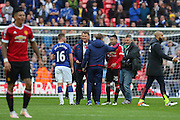 Manchester United Manager Louis van Gaal after the game with Everton midfielder James McCarthy during the The FA Cup semi final match between Everton and Manchester United at Wembley Stadium, London, England on 23 April 2016. Photo by Phil Duncan.