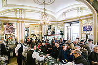 """NAPLES, ITALY - 24 NOVEMBER 2018: Customers and staff are seen here at Bar Gambrinus, in Naples, Italy, on November 24th 2018.<br /> <br /> My Brilliant Friend (Italian: L'amica geniale) is an Italian-American drama television miniseries based on the novel of the same name by Elena Ferrante. The series follows the lives of two perceptive and intelligent girls, Elena (sometimes called """"Lenù"""") Greco and Raffaella (""""Lila"""") Cerullo, from childhood to adulthood and old age, as they try to create lives for themselves amidst the violent and stultifying culture of their home – a poor neighborhood on the outskirts of Naples, Italy. My Brilliant Friend is a co-production between American premium cable network HBO and Italian networks RAI and TIMvision"""