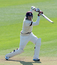 Somerset's Jamie Overton drives the ball. - Photo mandatory by-line: Harry Trump/JMP - Mobile: 07966 386802 - 07/04/15 - SPORT - CRICKET - Pre Season - Somerset v Lancashire - Day 1 - The County Ground, Taunton, England.