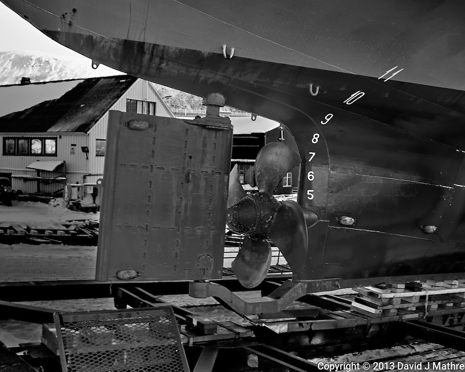 Aft rudder and screw on the Stallovarre. A passenger/Ro-Ro cargo ship being winched into a dry dock in Tromsø, Norway. Image taken with a Leica X2 camera (ISO 100, 24 mm, f/5.6, 1/50 sec). Raw image processed with Capture One Pro (including conversion to B&W).