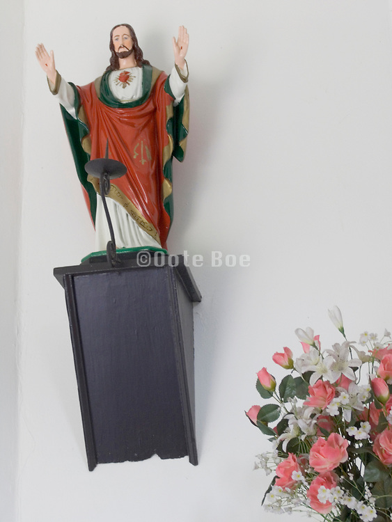 statue of Jesus in a small devotional chapel along the road Holland