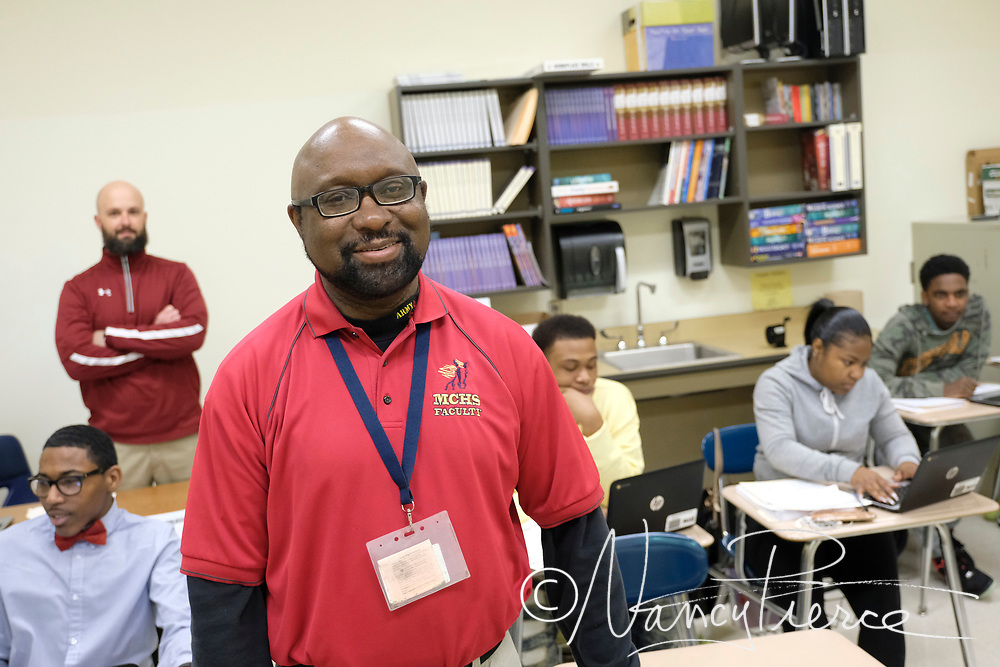 Timothy Rodman, Teacher Assistant of the Year at Mallard Creek High School, for North LC.  Here is is assisting in an EC class