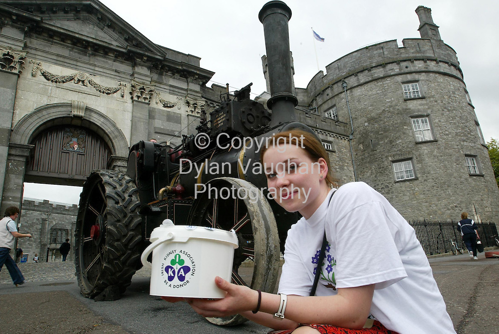 29/7/2004.Rebecca Leech from Wexford pictured in Kilkenny with one of the many Steam Engines taking part in the Irish Kidney Association in Association with Celtic Steamers, Steam Engine Road Run 2004 which will travel from Kilkenny to Stradbally County Laois from the 29th of July-31 of July..Picture Dylan Vaughan