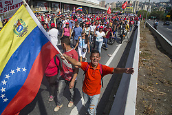 May 1, 2019 - Caracas, Venezuela - A supporter of Venezuelan President Nicolas Maduro demonstrates during a pro-government May Day rally in Caracas on May 1, 2019. Pro- and anti-government rallies are taking place in Venezuela, a day after violent clashes erupted in the capital following opposition leader Juan Guido's call on the military to rise up against Maduro, who claimed the insurrection had failed. (Credit Image: © Jonathan Lanza/NurPhoto via ZUMA Press)