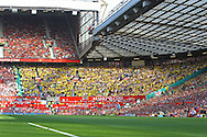 Picture by Paul Chesterton/Focus Images Ltd.  07904 640267.1/10/11.The Norwich fans before the Barclays Premier League match at Old Trafford Stadium, Manchester.