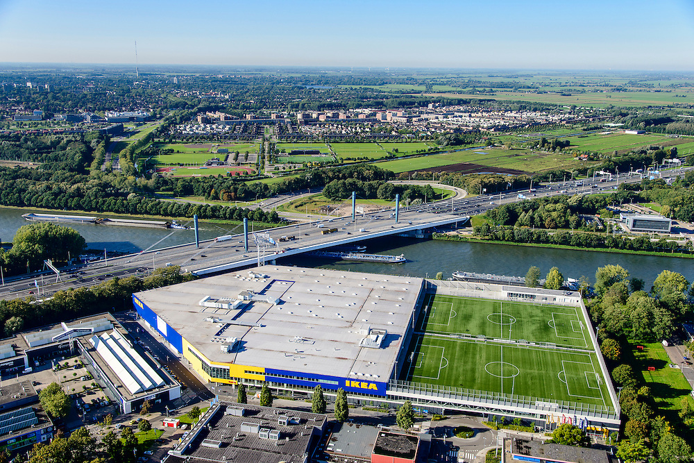 Nederland, Utrecht, Utrecht, 30-09-2015; Kanaleneiland, sportpark Azielaan van voetbalclub Faja Lobi KDS. De twee kunstgrasvelden zijn aangelegd op de parkeergarage van Ikea. <br /> Two artificial pitches are laid out on the car park of Ikea.<br /> <br /> luchtfoto (toeslag op standard tarieven);<br /> aerial photo (additional fee required);<br /> copyright foto/photo Siebe Swart