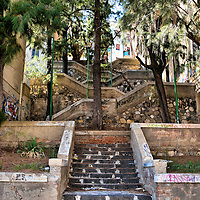 Switchback Staircase in Messina, Italy<br /> After Charles of Anjou became the King of Sicily in 1268, walls were constructed leading up the Caperrina Hill. His rule was crushed during the Sicilian Vesper uprising in 1282 and Messina was the scene of the last battles in Sicily to oust the French. You can almost feel this history as you trudged up the hill to see the Sanctuary of Montalto and Church of Christ the King. Their terraces also provide panoramic views of the city and the harbor. This switchback staircase called Scala Montevergine is near the Cloister of St. Eustochia and Monastery of Montevergine along XXIV Maggio street.