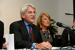 Former chief whip Andrew Mitchell speaks to press in Farringdon to give his reaction on the Crown Prosecution Service's decision on the 'Plebgate' row, accompanied by his wife, Dr Sharon Bennett (right),  David Davies MP and Stephen Parkinson.  Tuesday, 26th November 2013. Picture by Ben Stevens / i-Images